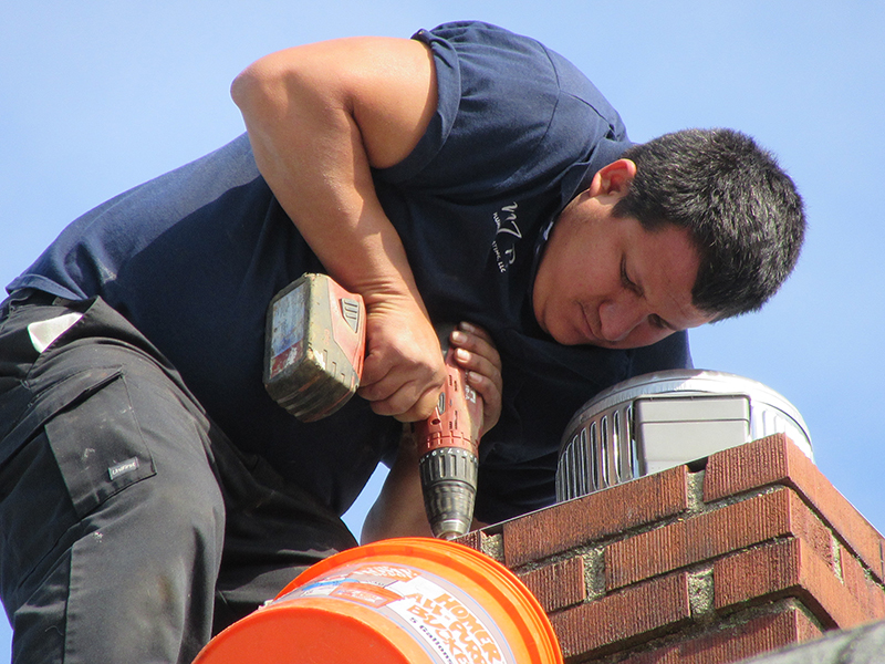 One-of-our-technicial-assistants-Edwin-installing-a-chimney-liner-for-a-boiler